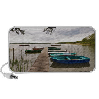 Moorings with boats on a lake iPhone speaker