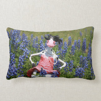 Mootilda the cow roams in the bluebonnets. lumbar cushion