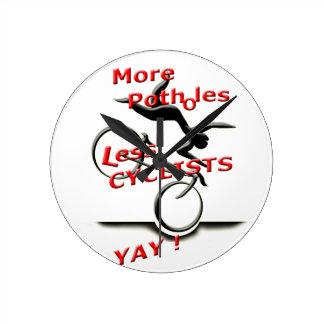 more potholes less cyclists ( yay ) wallclocks