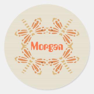 Morgan, dragonflies in orange & tan on black round sticker