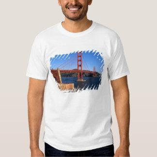 Morning light bathes the Golden Gate Bridge Tee Shirts