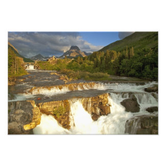 Morning light greets Swiftcurrent Falls in the Photograph