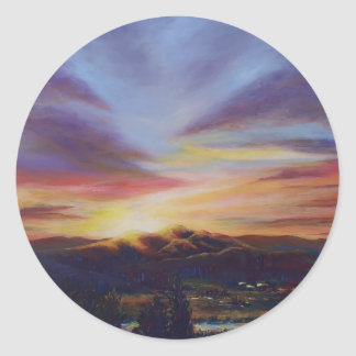 Morning light, sunrise over the hills round sticker