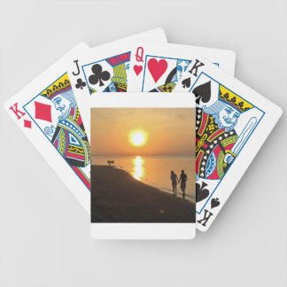 Morning walk on the beach bicycle playing cards