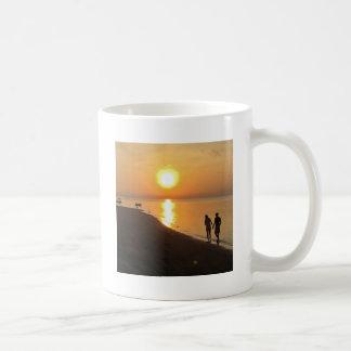 Morning walk on the beach coffee mug