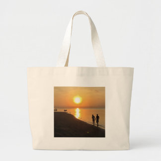 Morning walk on the beach large tote bag
