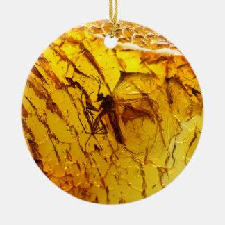 Mosquito inside amber ceramic ornament