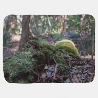 Moss covered fallen tree in a forest baby blanket