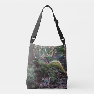 Moss covered fallen tree in a forest bag