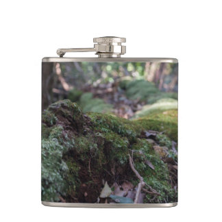 Moss covered fallen tree in a forest flask