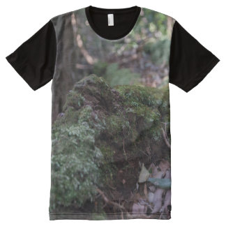 Moss covered fallen tree in a forest panel t-shirt