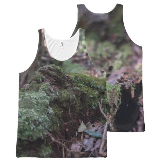 Moss covered fallen tree in a forest unisex vest