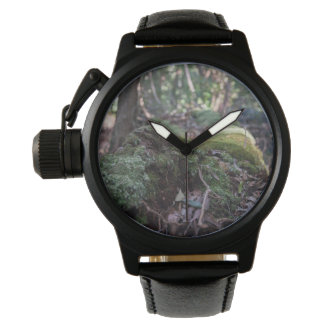 Moss covered fallen tree in a forest wrist watch