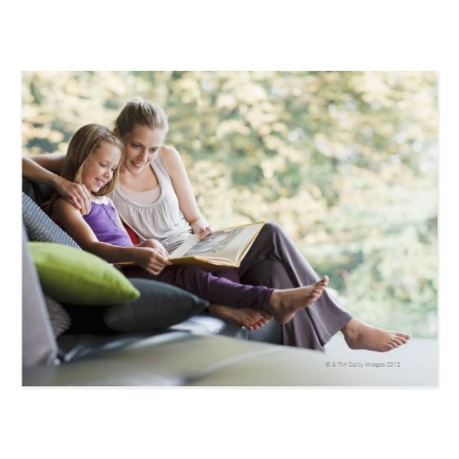 Mother and daughter reading storybook postcards
