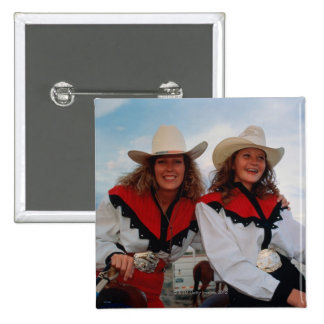 Mother and teenage daughter (14-16) at rodeo, buttons