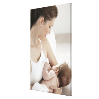 Mother breastfeeding baby 2 canvas print