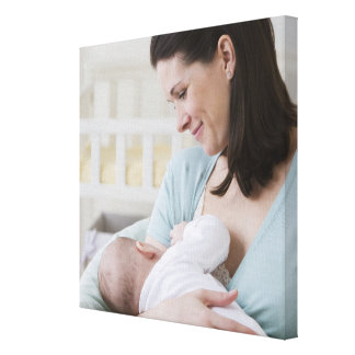 Mother breastfeeding baby canvas prints