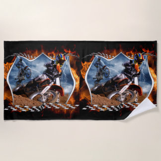 Motocross racer tearing up the track in the storm beach towel