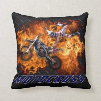 Motocross racing through fire. cushion