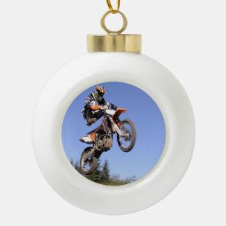 Motocross rider flying high ceramic ball christmas ornament