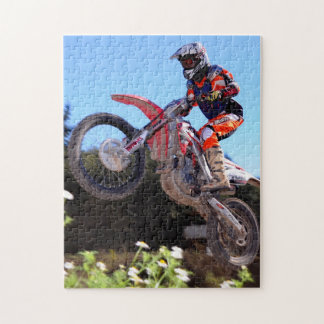 Motocross rider taking the jump jigsaw puzzle