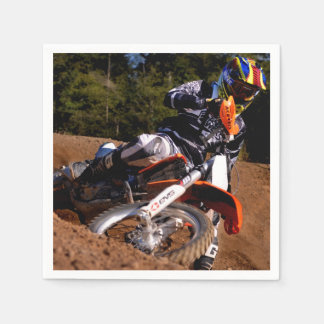 Motocross rider tearing up the track. paper napkins