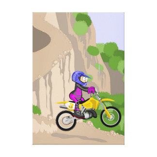 Motocross young lowering the hill at a high speed canvas print