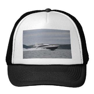 Motor cruiser at speed. mesh hat