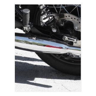 Motorcycle chromed exhaust pipe . Side view Postcard