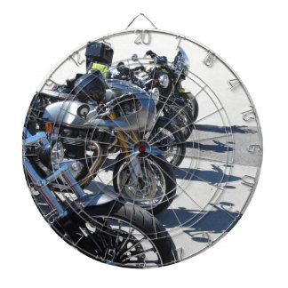 Motorcycles parked in row on asphalt dartboard