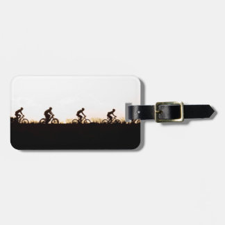 Mountain Bike Riders Make Their Way Over The Dam Bag Tag