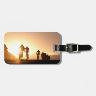 Mountain Bike Riders Make Their Way Over The Top Bag Tags