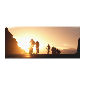 Mountain Bike Riders Make Their Way Over The Top Canvas Print