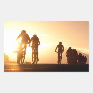 Mountain Bike Riders Make Their Way Over The Top Rectangular Sticker