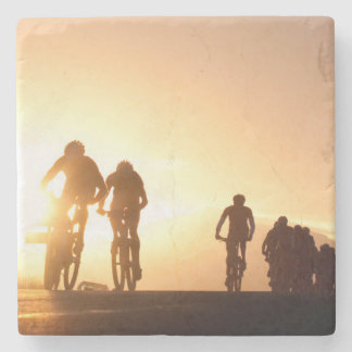 Mountain Bike Riders Make Their Way Over The Top Stone Coaster