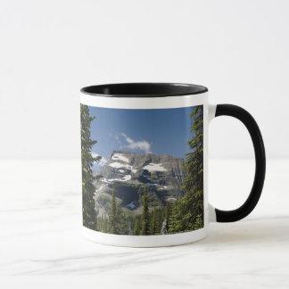 Mountain Peak Between Trees Under A Blue Sky Mug