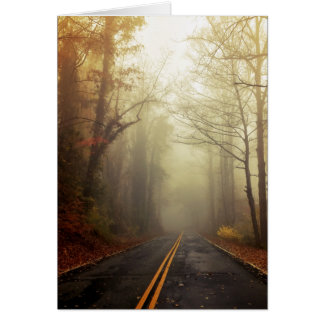 Mountain road on a foggy morning card