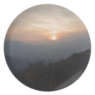 mountain sunset in a haze plate