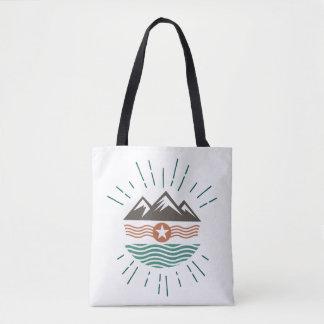 Mountains, sun and ocean tote bag