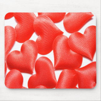 Mousepad with red Valentine' s day hearts.
