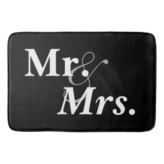 Mr. and Mrs. White on Black Bath Mats