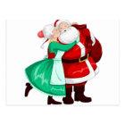 Mrs Claus Kisses Santa On Cheek And Hugs Postcard