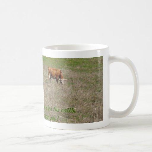 "Mug: Cow eating grass. ""God causes grass to grow."""