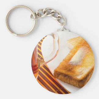 Mug of tea and hot toast with butter key ring