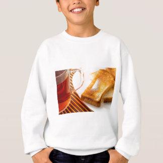 Mug of tea and hot toast with butter sweatshirt