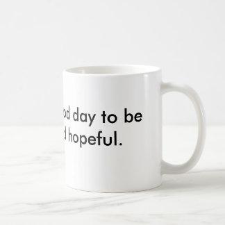 Mug saying be friendly & hopeful.