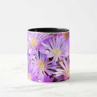 Mug with purple flowers close up