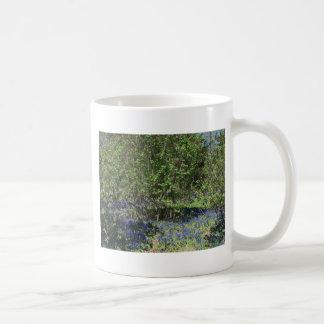 Mug with serene landscape and flower photo