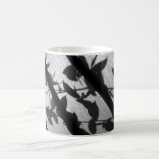 Mug with shadows of branches and leaves