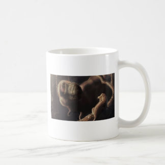 Mugs and playing cards with dinosaur artwork